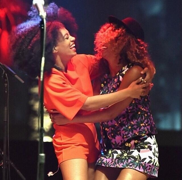Beyonce and Solange hug each other