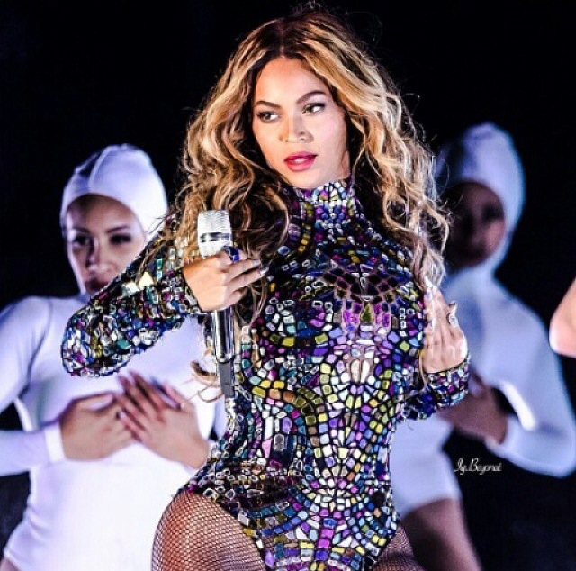 Beyonce performing in Tom Ford mosaic one-suit.