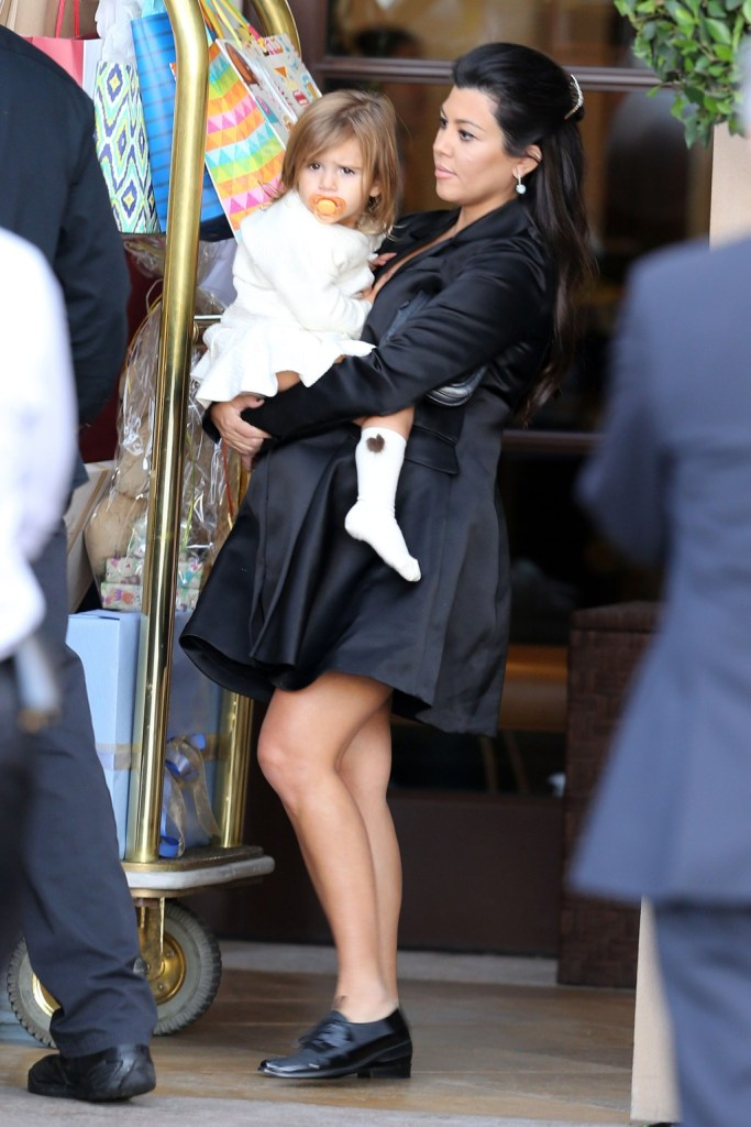 Kourtney Kardashian leaves her baby shower carrying her daughter Penelope from the Montage Hotel in Beverly Hills, CA