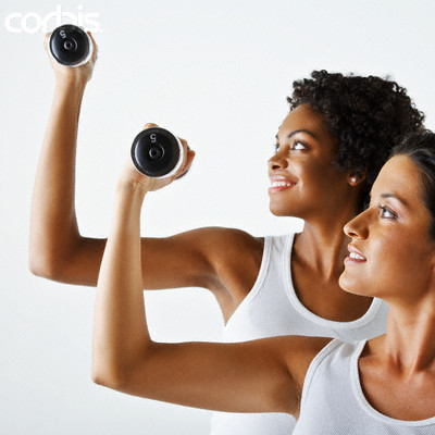 Two Women Exercising With Weights